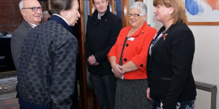 Morag (dressed in coral) meeting our Patron HRH The Princess Royal in November 2016